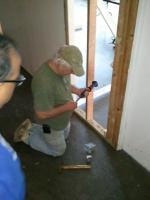 Attaching sill plate to gym floor.
